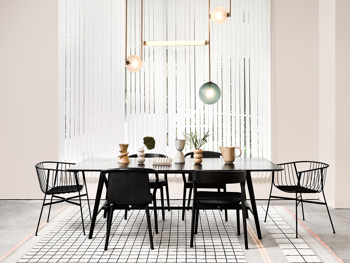 Introducing Australian design brand SP01 - minimal design - contemporary furniture - black dining table with black wire chairs